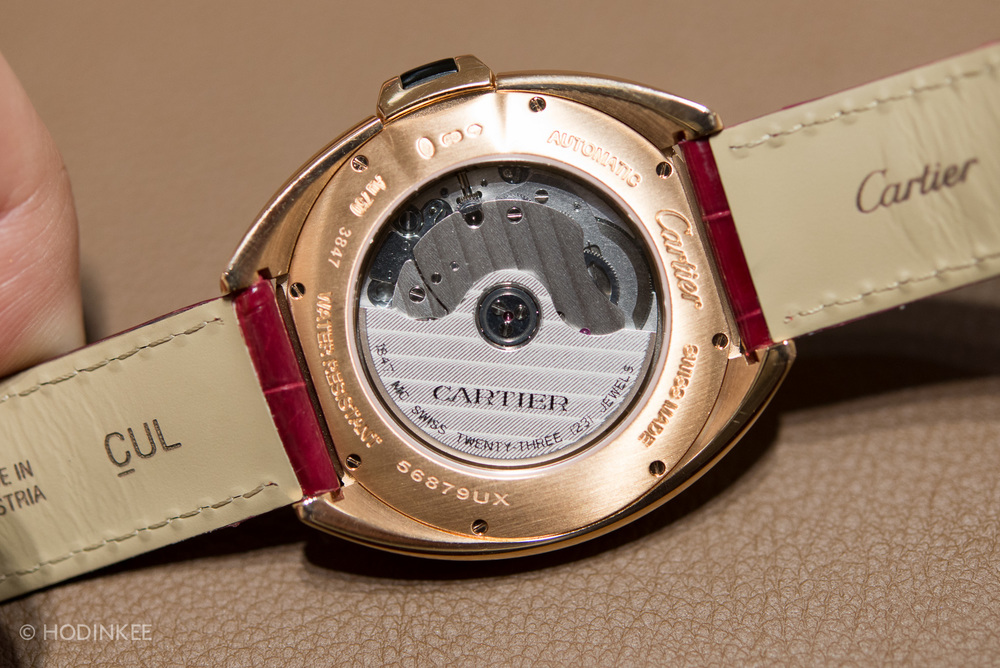 The in-house movement is decorated, to a basic-degree, with guilloché on the bridges and Cartier-signed rotor.